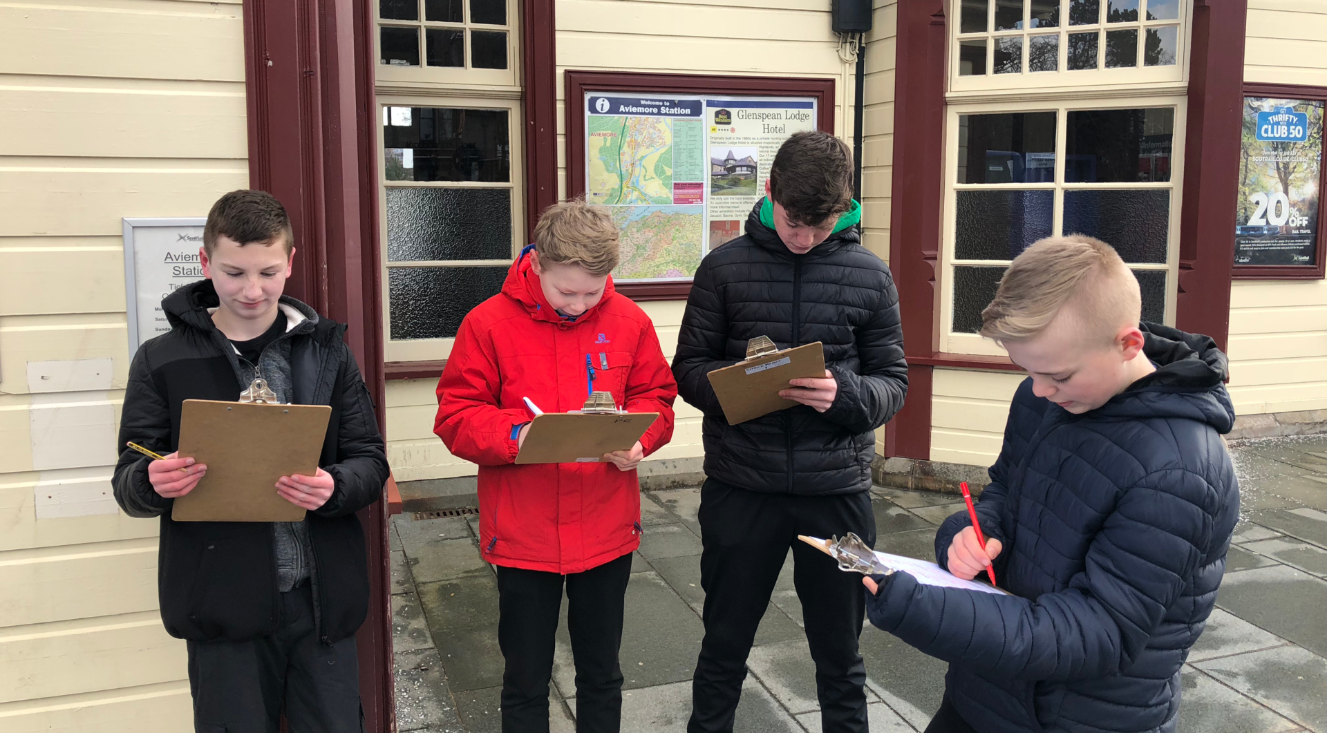 Pupils from Kingussie School write down ideas from An Camas Mòr