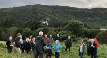People interested in An Camas Mòr on a tour of the site